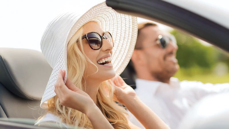 car-couple-laughing-soft-top